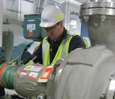 Siewert Service Technician performing laser alignment at University of Albany