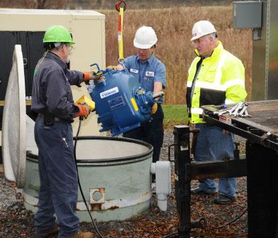 Siewert pump mechanics and Town Superivsor at a below ground Gorman Rupp pump station in Farmington NY
