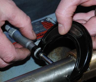 Pump service technicians checking shaft diameter