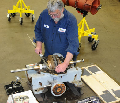 Pump service technician working on a two stage split case centrifugal pump