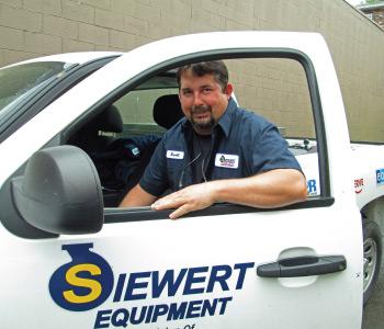 Siewert Equipment service technician with service truck