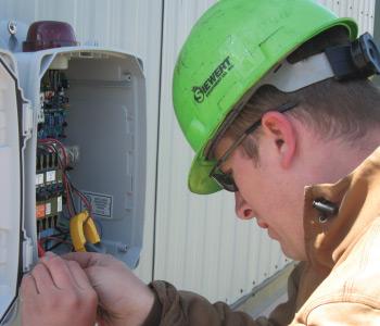 Siewert Equipment service technician trouble-shooting EONE pump station