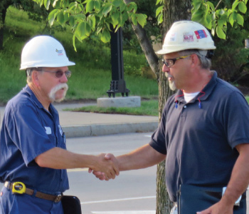 Siewert Service Technician planning pump removal with contractor