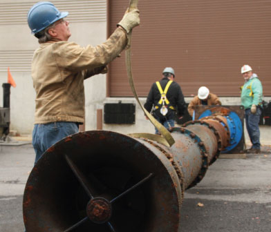 Vertical turbine pump being removed at Cornell University lake water pump station