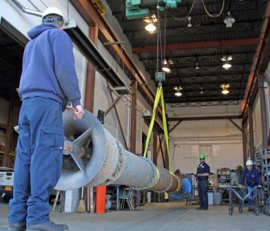 Siewert pump mechanics unloading Flowserve vertical turbine pump from Cornell University