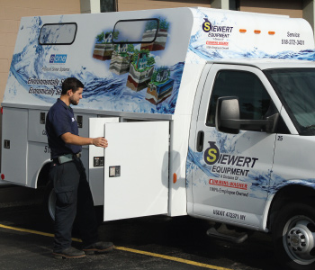 Siewert Equipment service technician with fully equipped eone service van for environment one pump service