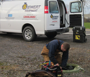 Siewert Equipment service technician replacing EONE pump in pump station