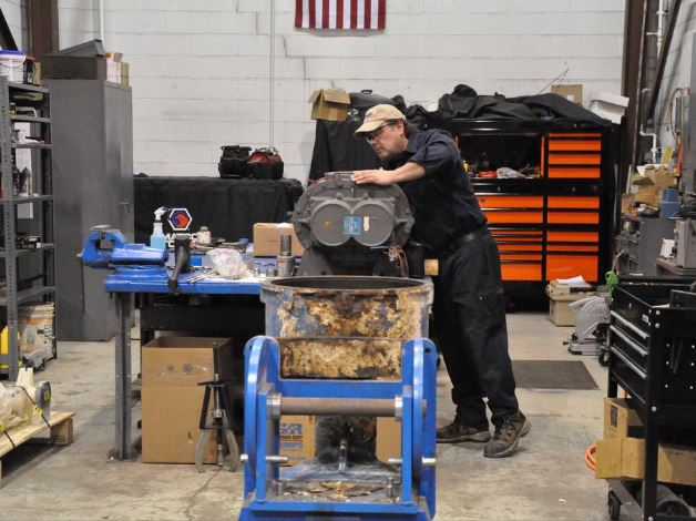 Siewert Equipment Service Supervisor in repair shop, for Albany Business Review article