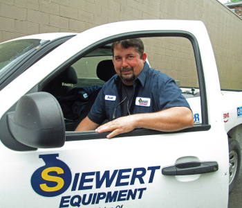 Siewert Equipment service technician with service truck,