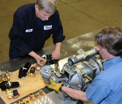 Pump service technicians working on a Warren Rupp AODD pump