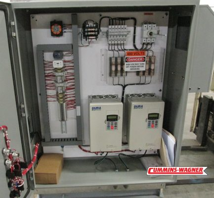 Inside of UL 508A Labeled control panel with flow and pressure monitoring and organized wiring.