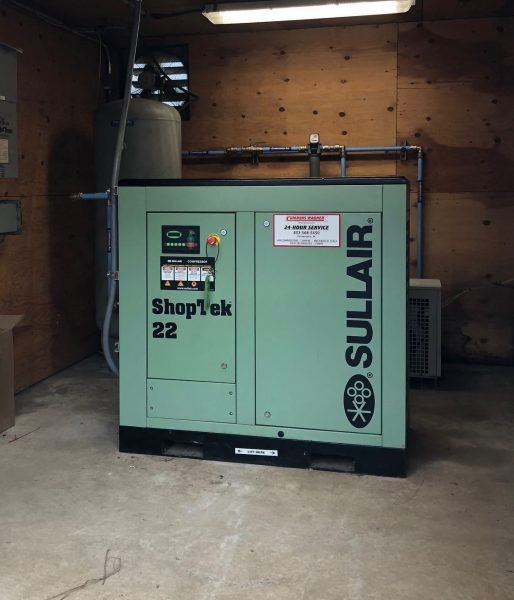 Relocation of compressed air equipment from one shed to another with a Sullair Shoptek compressor.
