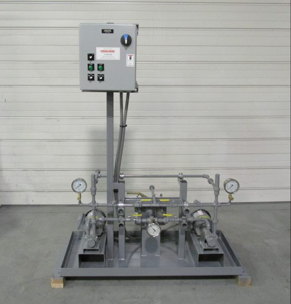 Duplex diesel fuel transfer package with manual motor control panel mounted on a painted steel base