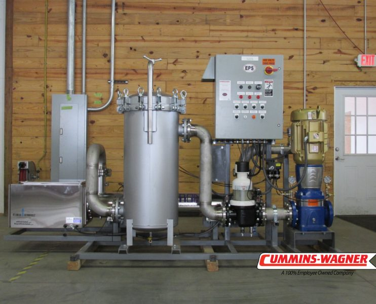 Ultraviolet disinfection package for industrial and commercial applications with stainless steel piping and self-cleaning filter.