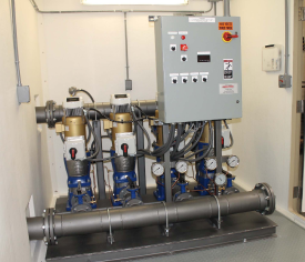Four Goulds Pumps in fiberglass building with VFD and automatic alternation providing constant pressure to customer.