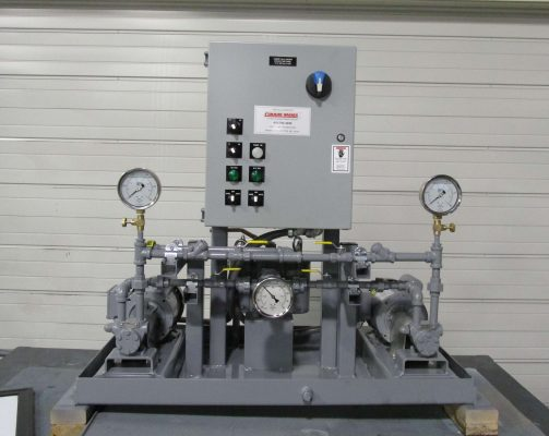 Low profile alternating fuel pumps with mechanical seals assembled on skid with valves, gauges and piping.