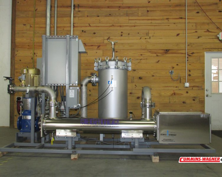 Back of Ultraviolet water treatment skid showing UV unit that disinfects water with germicidal lamps.