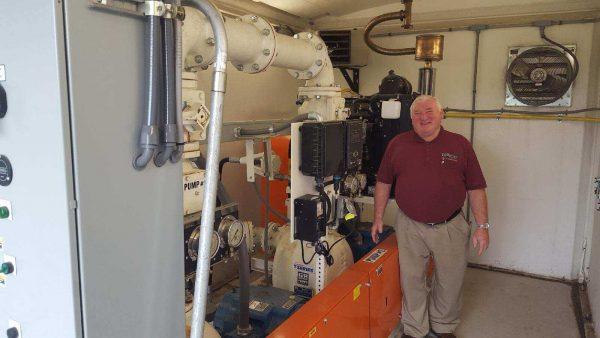 Town of Farmington Water & Sewer Superintendent standing inside a Gorman-Rupp above ground pump lift station.