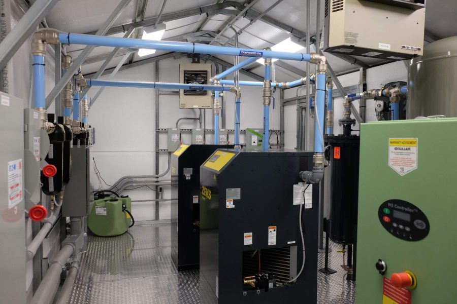 Insulated walls, lighting, and equipment including ZEKS Air Dryers, Sullair Wet Tank, Sullair Oil Water Separator.