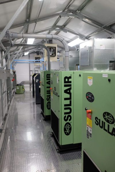 Sullair Compressors, wet tank, and air dryer in an insulated building package.