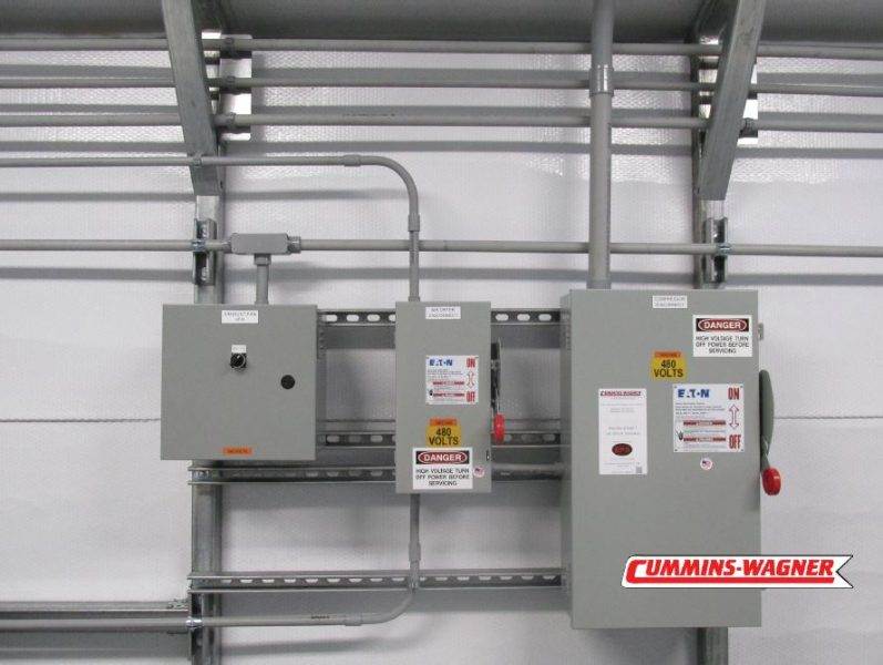 Equipment disconnects mounted to wall for Lock Out Tag Out (LOTO)