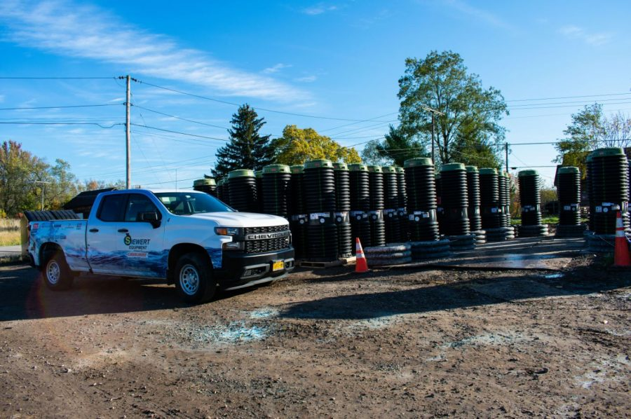 Siewert Equipment service truck by staging area of E/one grinder pumps in Port Bay NY