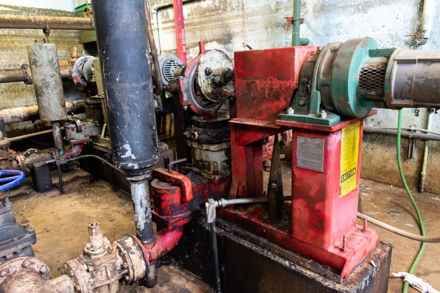 Old piston pump being replaced in a wastewater treatment plant in fulton ny